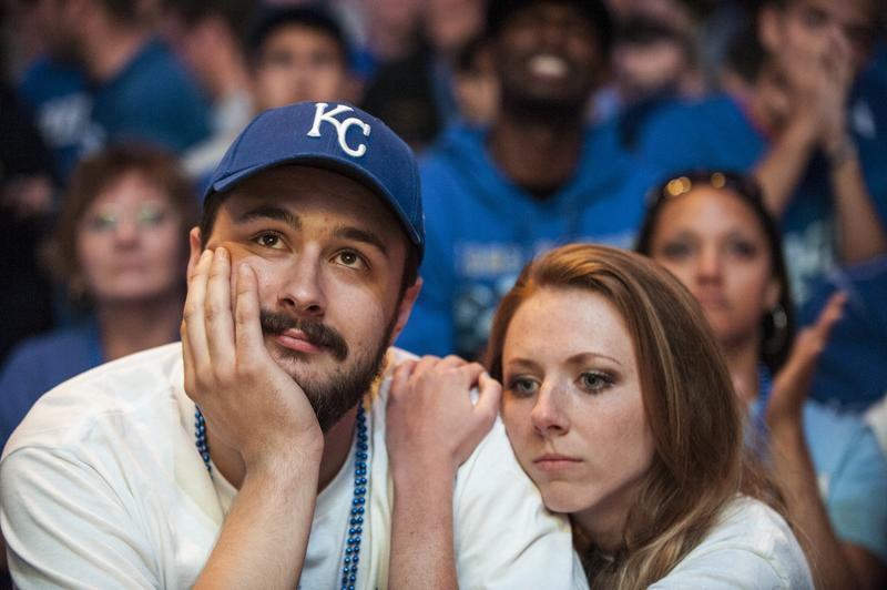 Kansas City Royals fans react to their team's defeat in the Power and Light District during Game Seven of the World Series on October 29, 2014 in Kansas City, Missouri.