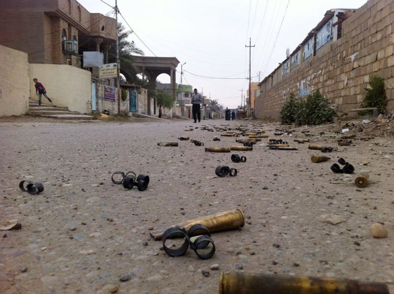 January 3, 2014: People in a street with empty bullets on the groud following fighting between Islamist jihadists and Iraqi special forces in the Iraqi city of Ramadi, west of Baghdad.