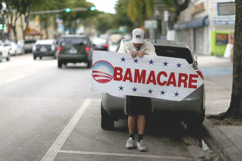 Pedro Rojas holds a sign directing people to an insurance company where they can sign up for the Affordable Care Act, also known as Obamacare, before the February 15th deadline on February 5, 2015.
