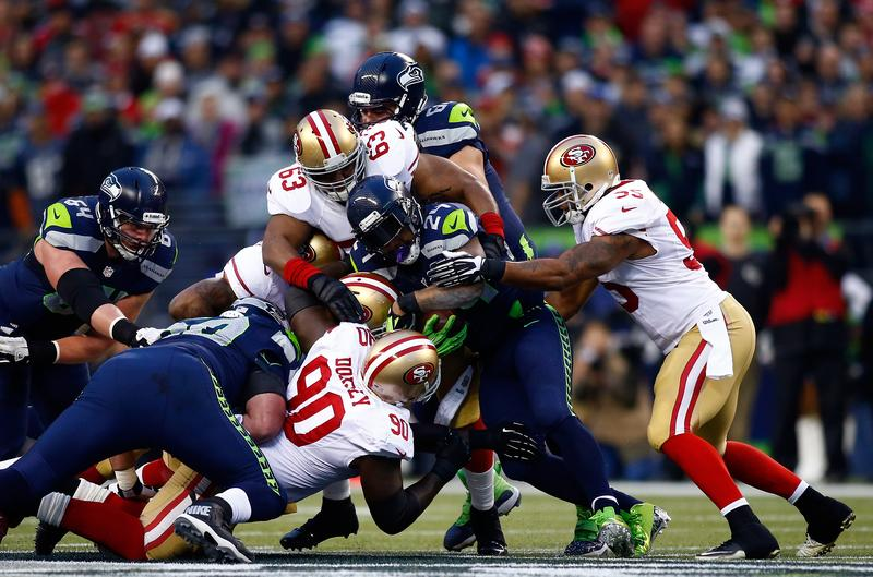 Running back Marshawn Lynch #24 of the Seattle Seahawks runs the ball against nose tackle Glenn Dorsey #90 of the San Francisco 49ers in the first half during the 2014 NFC Championship.
