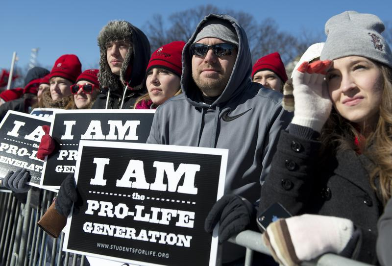 Thousands of anti-abortion demonstrators attend a rally on the National Mall during the 41st annual March of Life in Washington, DC, January 22, 2014.