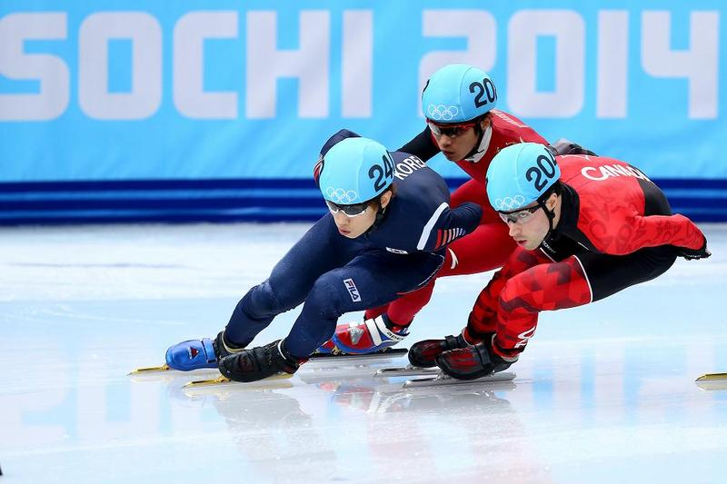 Han-Bin Lee of South Korea, Dequan Chen of China and Michael Gilday of Canada compete in Short Track Speed Skating on day 3 of the Sochi 2014 Winter Olympics.