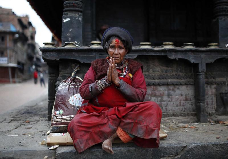 A woman is seen after a powerful earthquake hits Bhaktapur, Nepal on April 27, 2015.