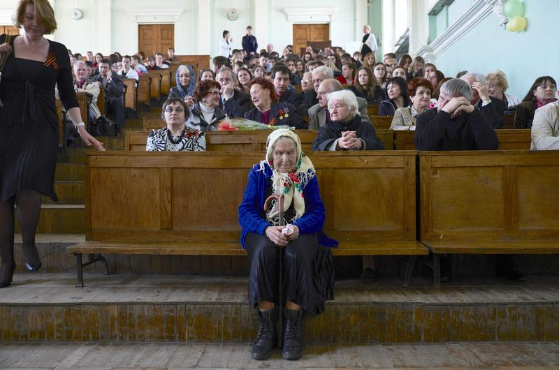 People attend as students and teachers of the University of Donetsk commemorate Victory Day on May 07 in Donetsk, Ukraine.