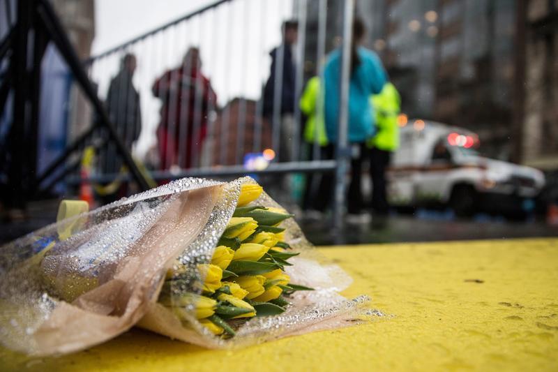 Flowers lie on the finish line of the Boston Marathon on the one year anniversary of the 2013 Boston Marathon Bombing, on April 15, 2014 in Boston, Massachusetts.