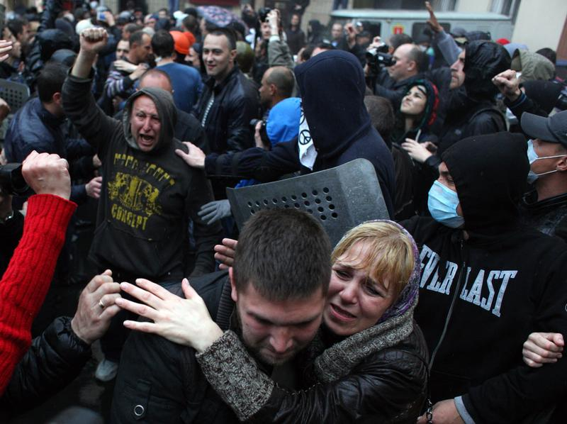 Pro-Russian militants, who were arrested during a Ukrainian unity rally on May 2, react after being freed by police, following the storming of a police station in Odessa. May 4, 2014