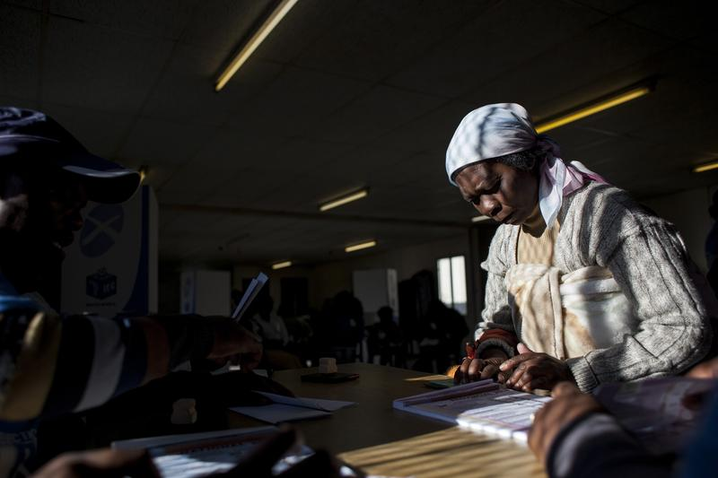 Voters prepare to vote inside the Icebelihle Labantu Abadala Voting Station in Greenpoint district of Khayelitsha Township on May 7, 2014 in Cape Town, South Africa.