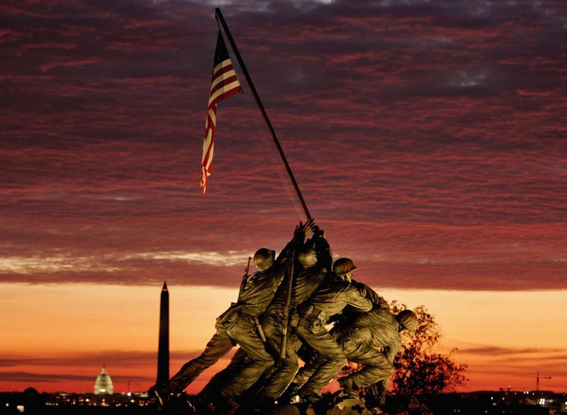 The early morning sun begins to rise behind the Iwo Jima Memorial on November 11, 2004 in Arlington, Virginia.