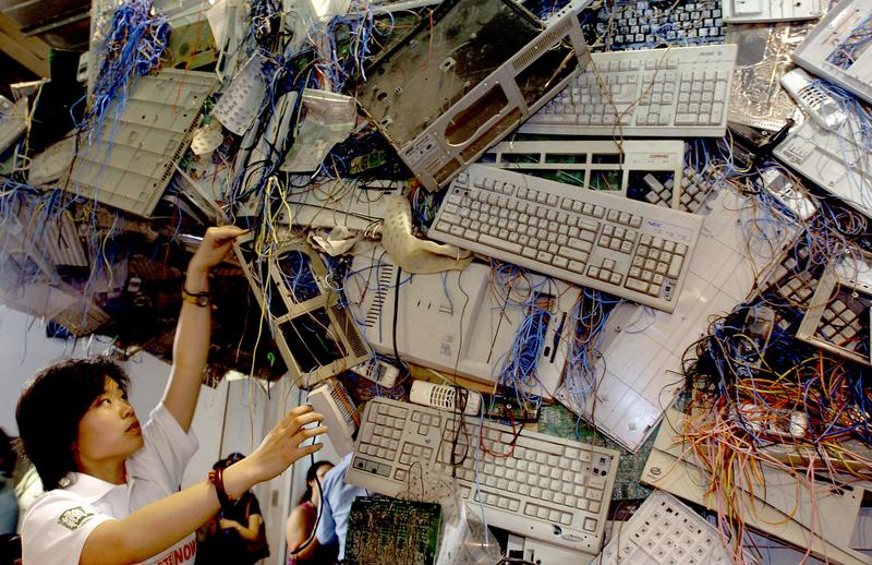 Chinese Greenpeace activists set up an E-waste sculpture at the China International High-tech exhibition in an effort to shame the companies attending the expo on May 23, 2005 in Beijing.