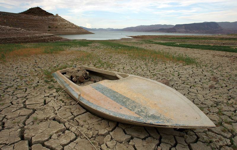 A mud-covered boat is seen in an area that was until recently underwater. July 26, 2007 in the Lake Mead National Recreation Area, Nevada.