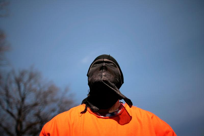A demonstrator dresses as a 'detainee' during a rally to 'demand Congressional action to stop torture' by The Washington Region Religious Campaign Against Torture on Capitol Hill March 10, 2008.
