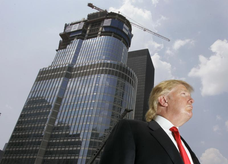 Donald Trump is profiled against his 92-story Trump International Hotel & Tower during a news conference on construction progress in Chicago, May 24, 2007.