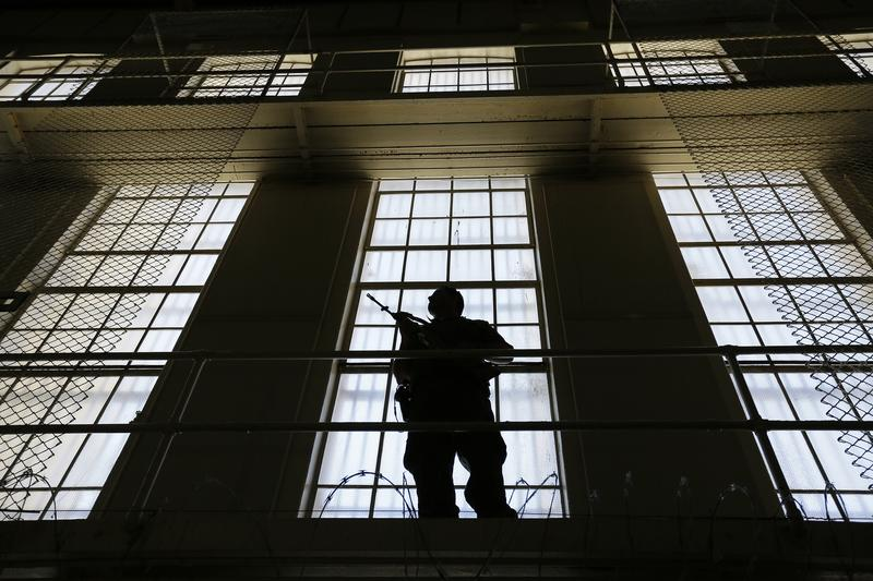 A guard stands watch over the east block of death row at San Quentin State Prison Tuesday, Aug. 16, 2016, in San Quentin, Calif.