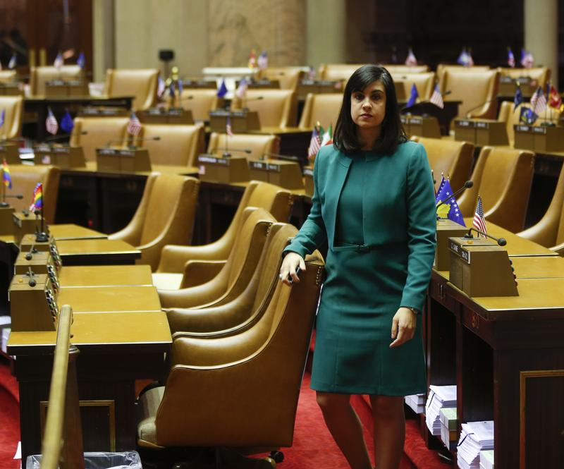 In this Jan. 22, 2015 file photo, Assemblywoman Nicole Malliotakis, R-Staten Island, walks through the Assembly Chamber at the Capitol in Albany, N.Y.