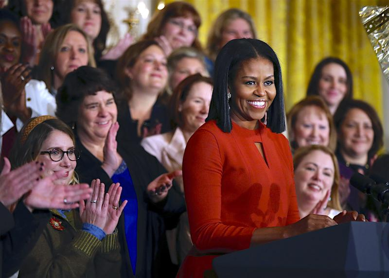 In this Jan. 6, 2017, file photo, First lady Michelle Obama smiles as she speaks at the 2017 School Counselor of the Year ceremony in the East Room of the White House.