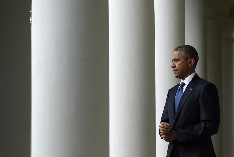 President Barack Obama walks to the Rose Garden of the White House in Washington, Friday, June 26, 2015.