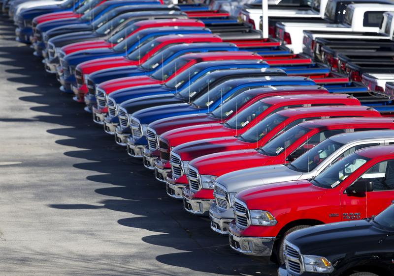 In this Jan. 5, 2015, file photo, Dodge Ram pickup trucks are on display on the lot at Landmark Dodge Chrysler Jeep RAM in Morrow, Ga.