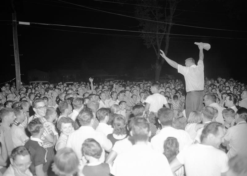 Residents of Levittown, a planned community of 60,000, gather at a meeting in Levittown, Penn., to hear a discussion of plans by William Myers, a black man, to move into an all-white community in 1957