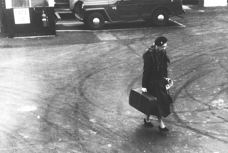 Eleanor Roosevelt carrying her suitcase at LaGuardia Airport, New York in 1960.