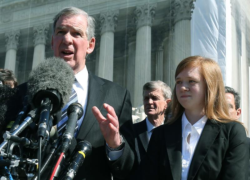 Attorney Bert Rein (L), speaks to the media while standing with plaintiff Abigail Noel Fisher (R), after the U.S. Supreme Court heard arguments in her case on October 10, 2012 in Washington, DC.