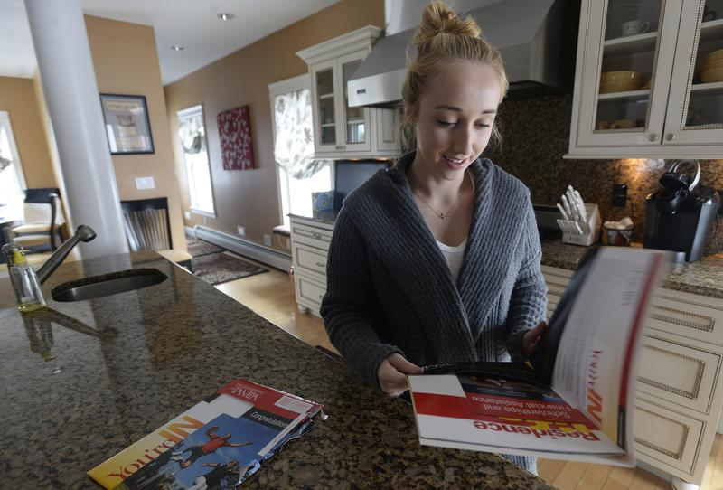 Gabriella Latini opens her acceptance letter from the University of Tampa Tuesday, March 17, 2015.