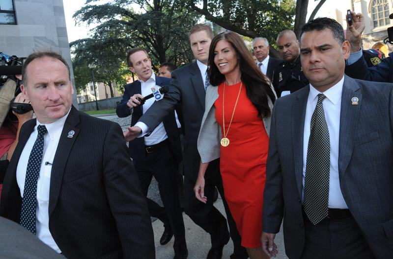 Embattled Pennsylvania Attorney General Kathleen Kane walks out of the Montgomery County Courthouse in Norristown, Pa., surrounded by her security detail on Monday, Aug. 24, 2015.