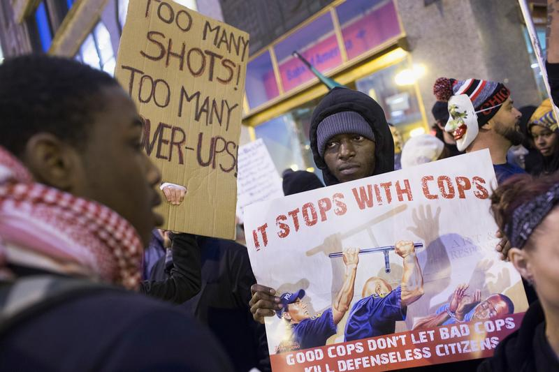 Demonstrators march through downtown on December 12, 2015 in Chicago, Illinois.