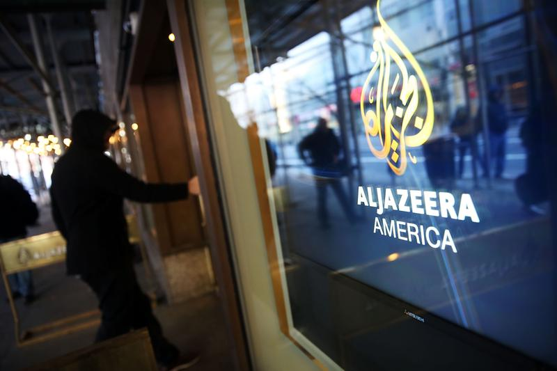 The logo for Al Jazeera America is displayed outside of the cable news channel's offices on January 13, 2016 in New York City.