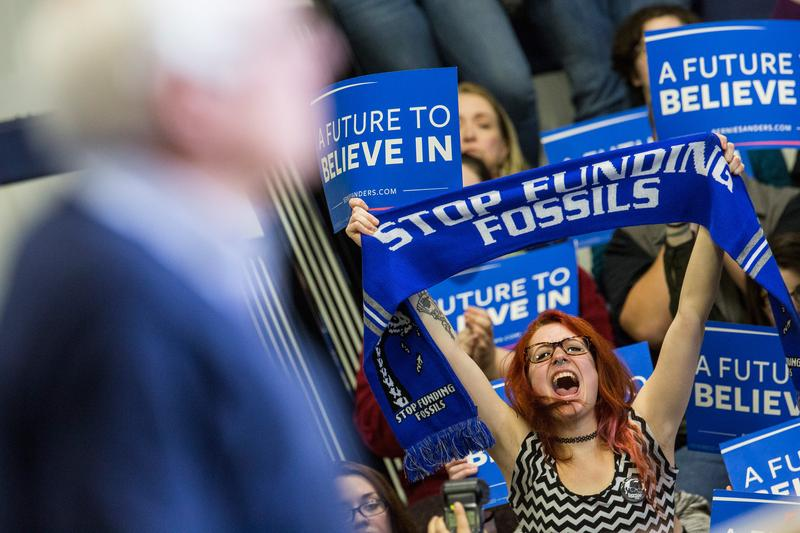 Audience members cheer during a speech by Democratic presidential candidate Sen. Bernie Sanders (D-VT) at a campaign rally at Great Bay Community College on Feb. 7, 2016 in Portsmouth, New Hampshire.