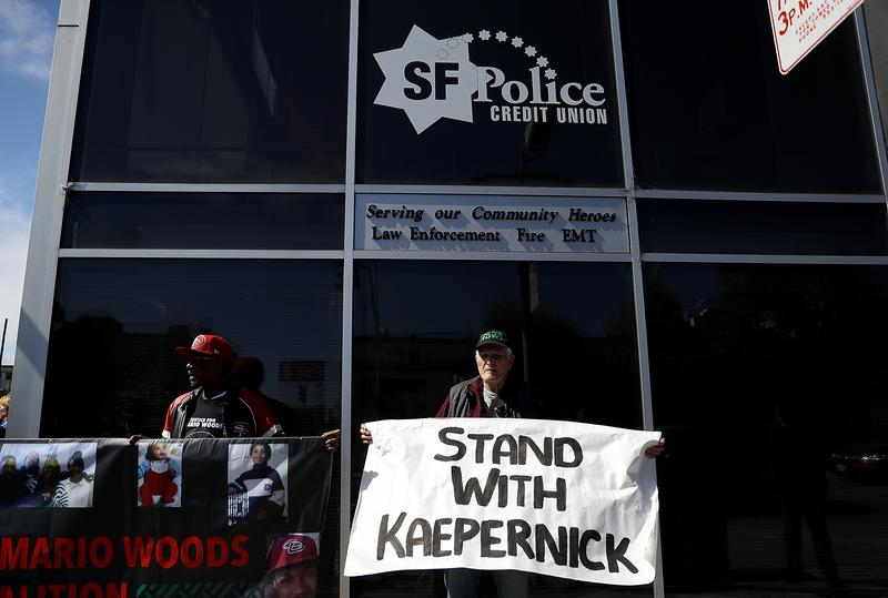 Protestors demonstrate in support of San Francisco 49ers quarterback Colin Kaepernick outside of the San Francisco Police Officers Association offices on August 31, 2016 in San Francisco, California.