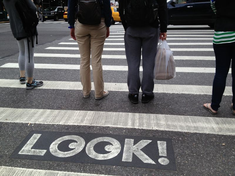 Look! Crosswalk sign urging pedestrians to pay attention