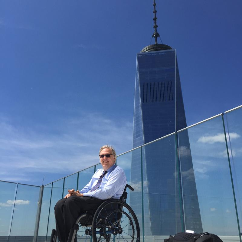 Takeaway Host John Hockenberry pictured next to the Freedom Tower.