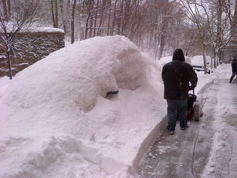 Snowblower buries a car in Inwood