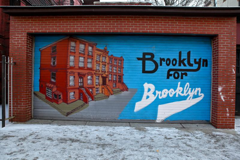 Painted garage in Bedford-Stuyvesant, Brooklyn. Households in this census tract matches the city's median income.