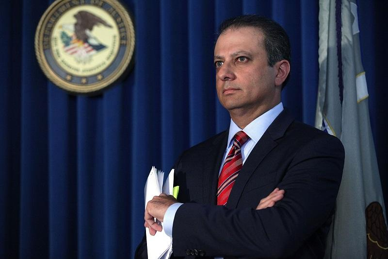 U.S. Attorney Preet Bharara pauses at a news conference in Manhattan to announce that Federal prosecutors have reached an agreement with General Motors.