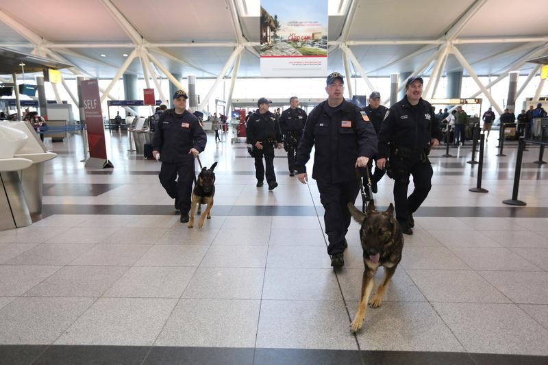 NYPD Canine Team officers departing from John F. Kennedy International Airport Thursday morning to aid in recovery efforts in the Washington state mudslide
