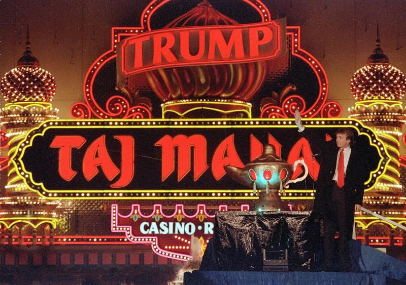 Donald Trump visits his Trump Taj Mahal Casino Resort to mark its opening in Atlantic City, N.J., in April of 1990. A year later, the casino collapsed into bankruptcy.