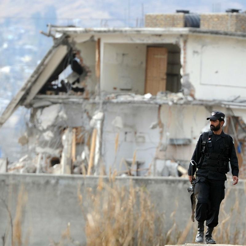 Pakistani policeman patrol near the demolished Abbottabad compound.
