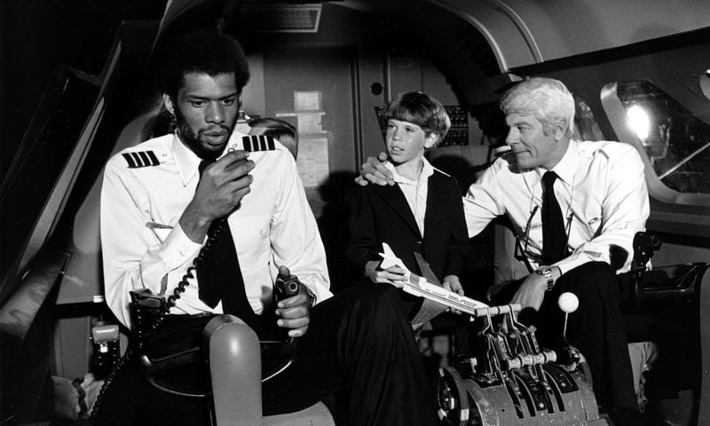 "Kareem Abdul-Jabbar, L, and Peter Graves, R, in the 1980 film ""Airplane!"""