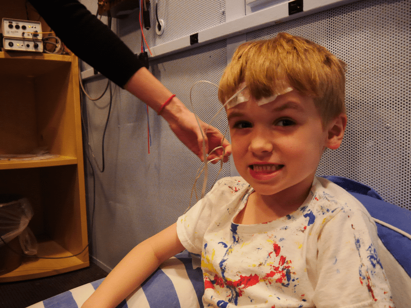 A young boy gets an EEG to measure his brain's response to sound at the Auditory Neuroscience Lab at Northwestern University.