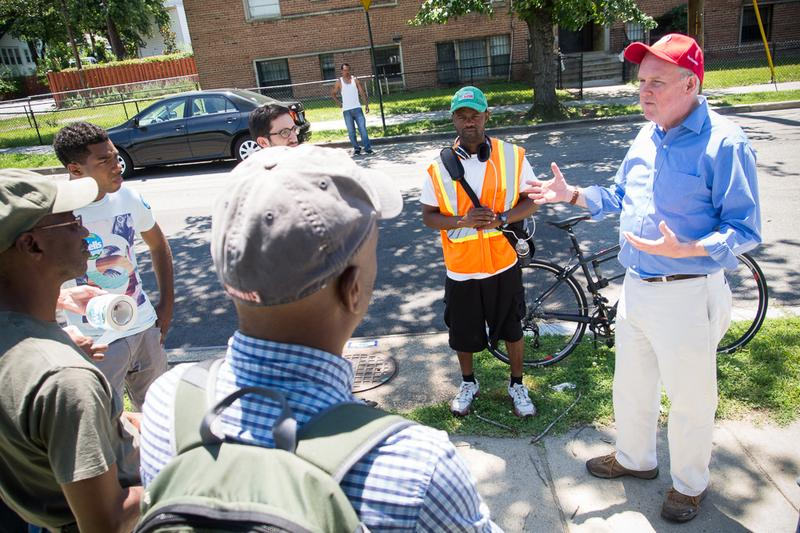 A group of volunteers talk before canvasing in a neighborhood in ward 7 in Washington, DC.