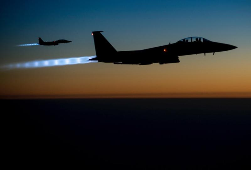 U.S. Air Force F-15 Strike Eagles conducting combat operations in Iraq against ISIS targets.