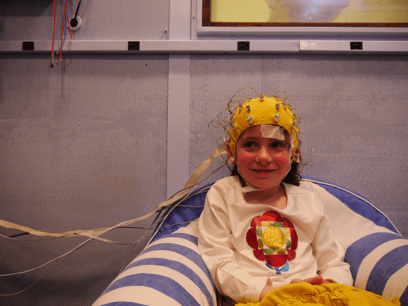 A young girl gets an EEG to measure her brain's response to sound at the Auditory Neuroscience Lab at Northwestern University.
