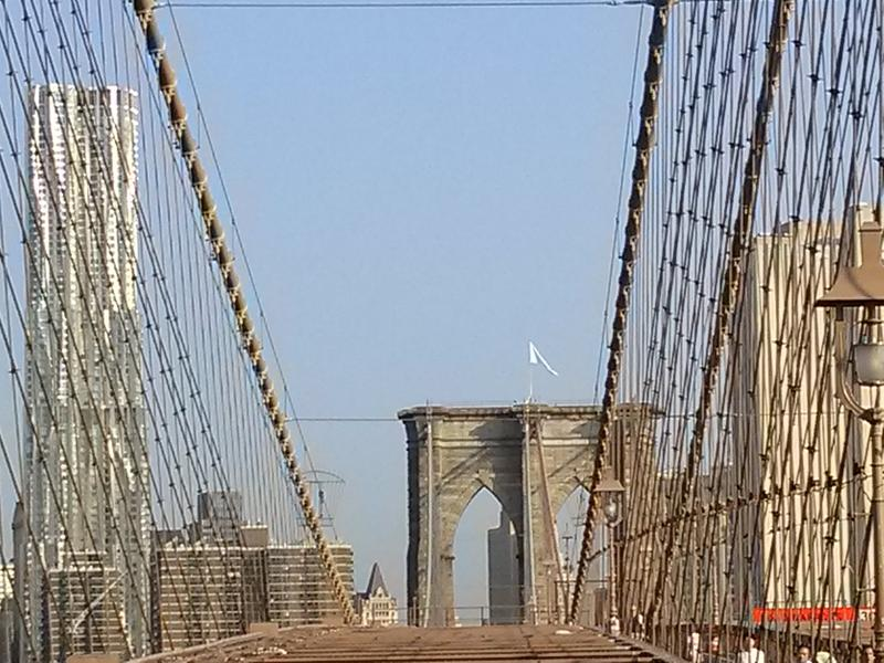 A mysterious white flag flies above the Brooklyn Bridge Tuesday morning