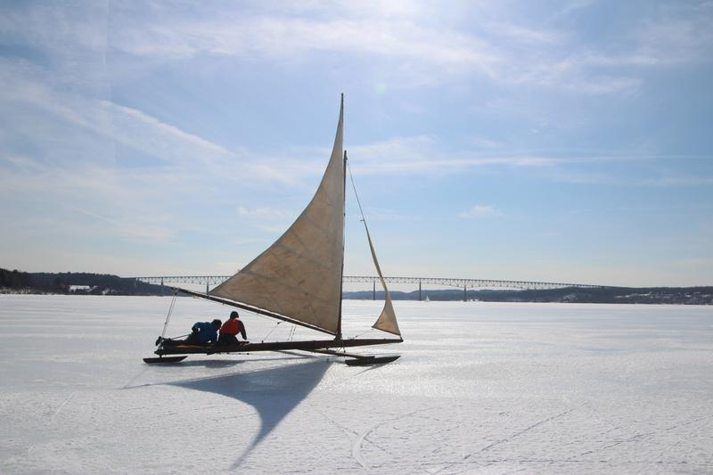 An antique ice yacht on the Hudson, with the Kingston-Rhinecliff bridge in the background.