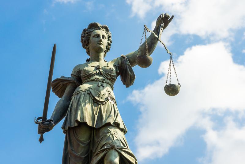 Statue of Lady Justice in the Romerplatz of Frankfurt, Hessen, Germany.