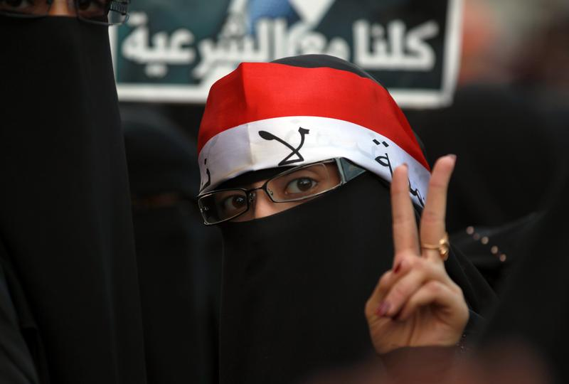 A Yemeni woman flashes the V-sign for victory during a rally commemorating the second anniversary of a major clash between opposition protesters against former Yemeni president Ali Abdullah Saleh.
