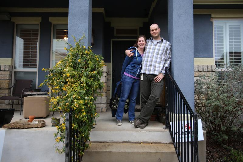 Kathy Sokolic and her husband, Mike Sears, outside their home in the Muëller community