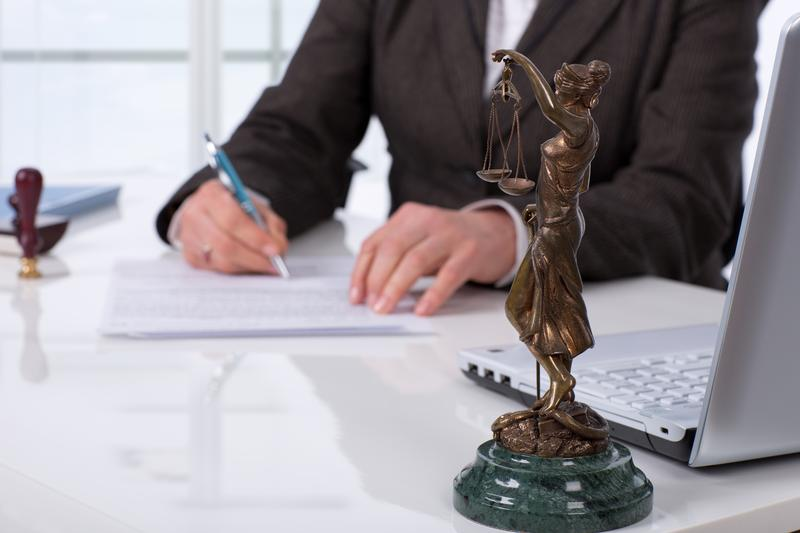 Notary signs document in workplace.