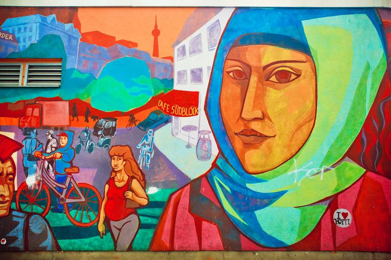 Urban graffiti with face of woman in hijab living in area of immigrants on Septemper 1, 2015.